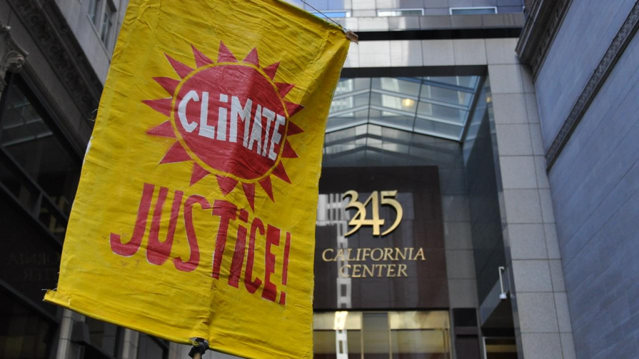 Climate Justice Banner at Make Big Oil Pay March in San Francisco https://www.flickr.com/photos/rainforestactionnetwork/4944104220/